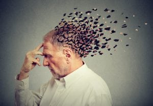 Artistic photo of a man's head breaking up and falling away